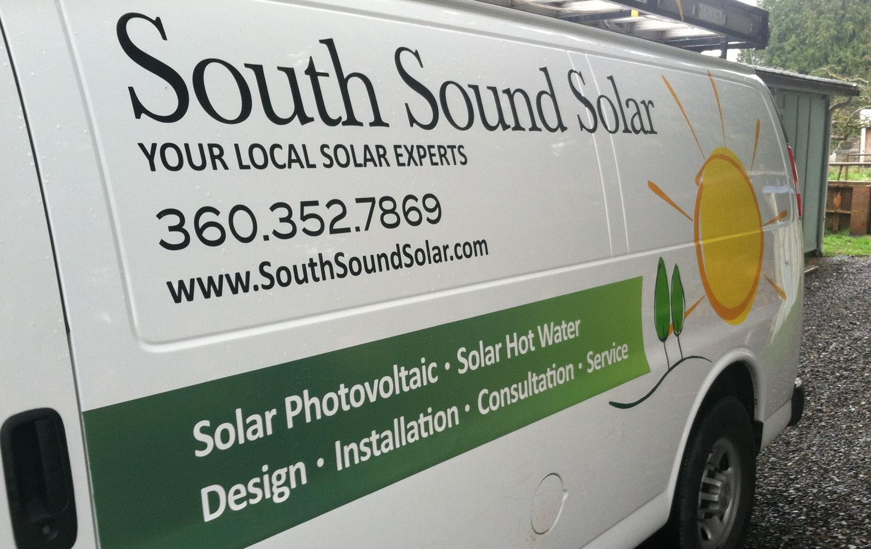 Photo of the side of a South Sound Solar van, with the logo and details all showing.